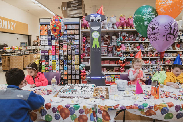 """&quot;A party to celebrate Marty, a floor cleaning robot's, first birthday last month at the Stop &amp; Shop in Yonkers, N.Y., via <a href=""""https://www.nytimes.com/2020/02/26/business/robots-retail-jobs.html"""">Should Robots Have a Face? - The New York Times</a>&quot;"""
